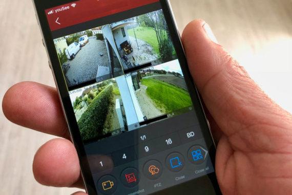 Smartphone med billeder af videoovervågnings kameraer